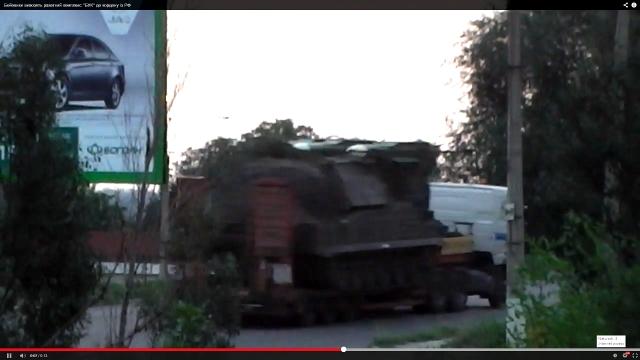 9A310M1 Buk-M1 TELAR transported on civilian truck.