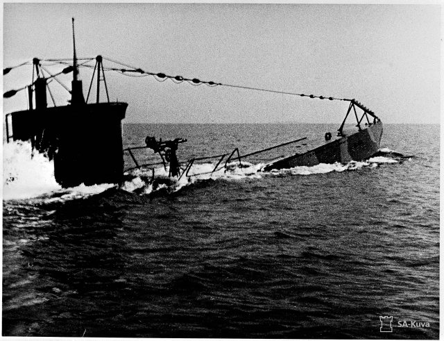 The Finnish submarine service that was: light submarine Vesikko surfacing sometime during the war years. Source: SA-kuva