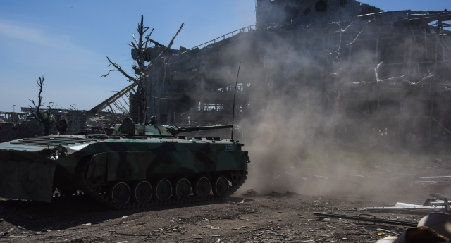 An infantry tank near ruins of Donetsk International Airport. Ea
