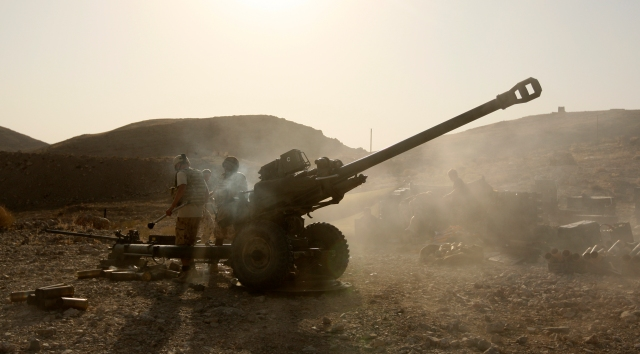 ISAF Soldiers Fire a 105mm Light Gun