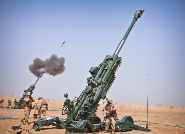 charlie_battery2c_1st_battalion2c_12th_marine_regiment2c_fire_an_m982_excalibur_round_from_an_m777_howitzer
